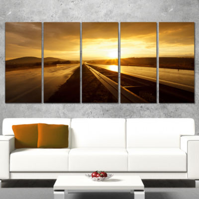 Designart Wet After Rain Road at Sunset Extra Large Wall ArtLandscape - 4 Panels
