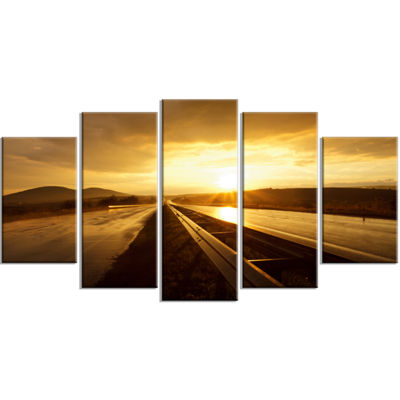 Designart Wet After Rain Road at Sunset Extra Large WrappedWall Art Landscape - 5 Panels