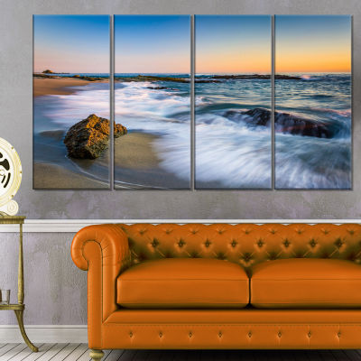 Designart White Waves Crashing on Rocks Seascape Canvas ArtPrint - 4 Panels