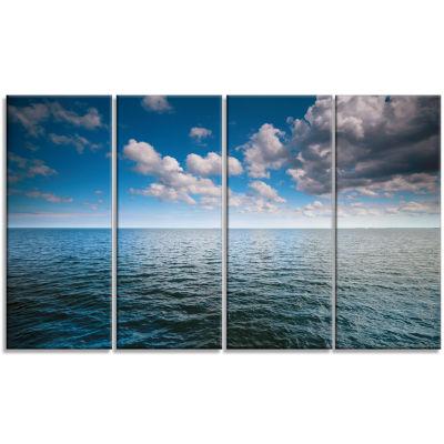 Cloudy Blue Sky Above Sea Surface Oversized BeachCanvas Artwork - 4 Panels