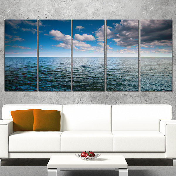 Designart Cloudy Blue Sky Above Sea Surface Oversized BeachWrapped Canvas Artwork - 5 Panels