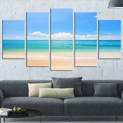 Designart Cloudy Horizon Over Beach Seashore PhotoCanvas Print - 4 Panels