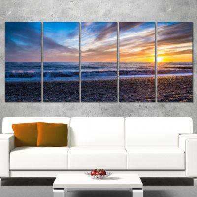 Designart Cloudy Sky with Bright Full Yellow Sun Beach PhotoCanvas Print - 5 Panels
