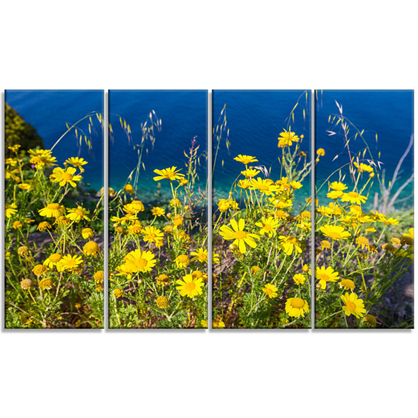 Designart Wild Yellow Flowers Over Sea Coast LargeFlower Canvas Art Print - 4 Panels