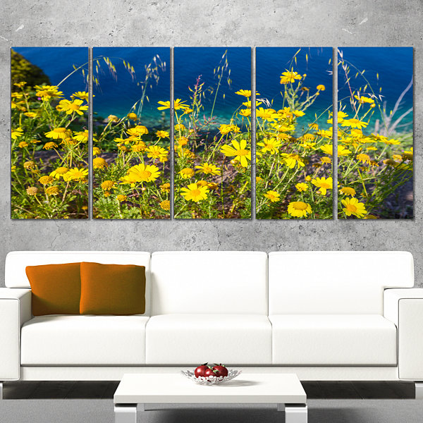 Designart Wild Yellow Flowers Over Sea Coast LargeFlower Canvas Art Print - 5 Panels