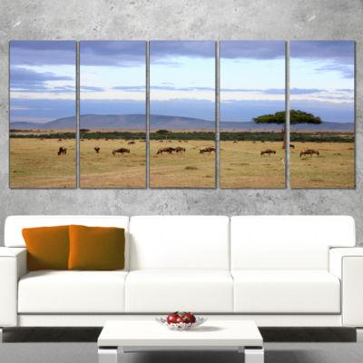 Designart Wildebeest Herd in Masai Mara OversizedAfrican Landscape Canvas Art - 4 Panels