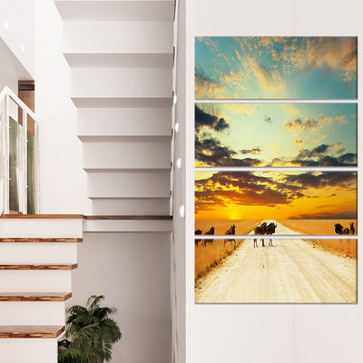 Designart Wildebeests Crossing Path in Evening African Landscape Canvas Art Print - 4 Panels