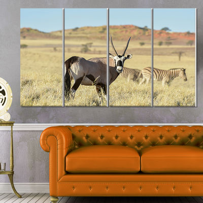 Designart Wildlife in Namibia Grassland African Canvas Art Print - 4 Panels