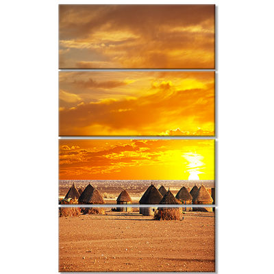 Designart Colorful African Village Huts View ExtraLarge Landscape Canvas Art - 4 Panels