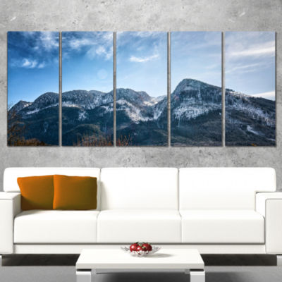 Designart Winter Mountains with Sun Flare Landscape Canvas Art Print - 4 Panels