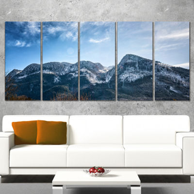 Designart Winter Mountains with Sun Flare Landscape WrappedArt Print - 5 Panels