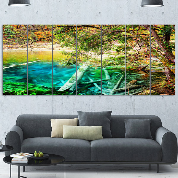 Designart Colorful Lake with Tree Trunks LandscapeCanvas Wall Art - 4 Panels