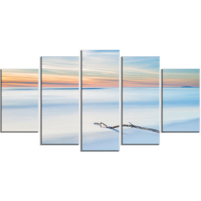 Designart Wood Branch on Beach at Twilight ModernSeascape Wrapped Artwork - 5 Panels