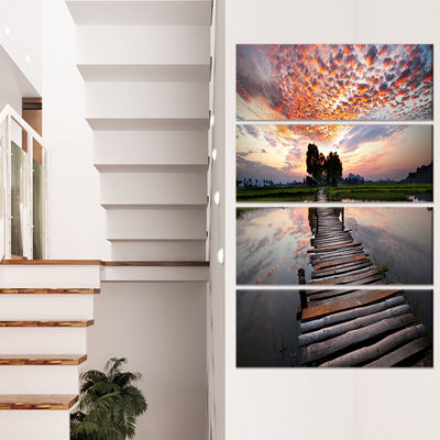 Designart Wooden Bridge Under Dramatic Sky Seashore Canvas Art Print - 4 Panels