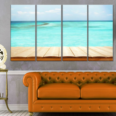 Designart Wooden Planks on Sea Background SeascapeCanvas Art Print - 4 Panels