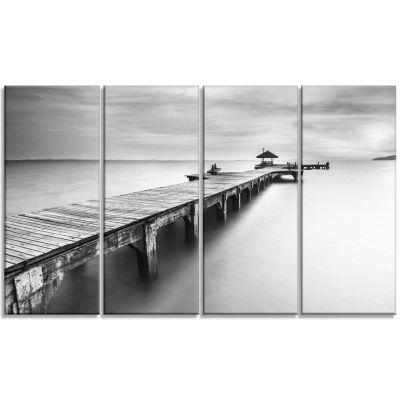 Designart Wooden Sea Bridge Seascape Photography Canvas ArtPrint - 4 Panels
