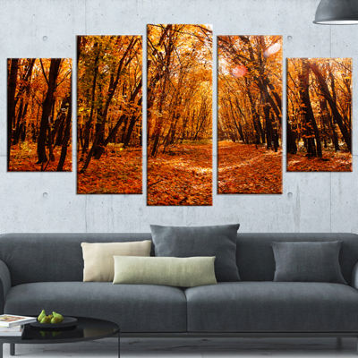 Designart Yellow Falling Leaves in Forest Landscape Photo Canvas Art Print - 5 Panels