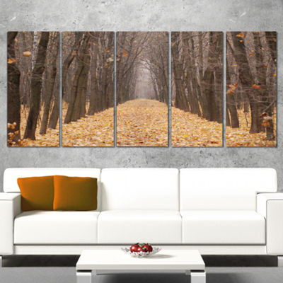 Designart Yellow Road Through Fall Forest Modern Forest Canvas Art - 5 Panels