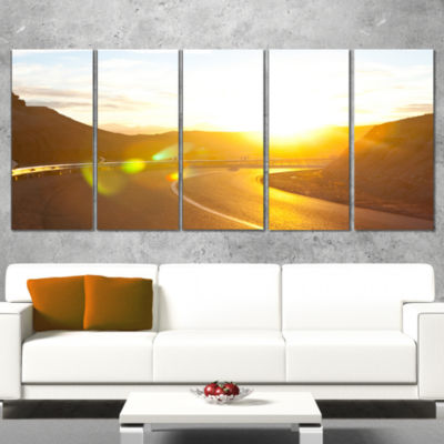 Designart Yellow Road Under Sunset Oversized Landscape Canvas Art - 4 Panels