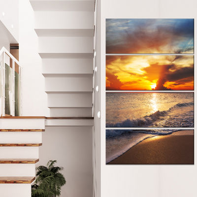 Designart Yellow Sunset Through Dark Clouds LargeSeashore Canvas Print - 4 Panels