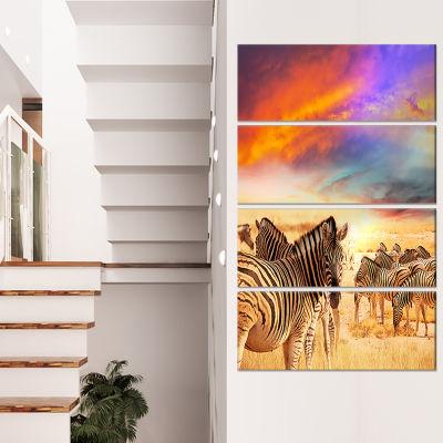 Designart Zebra Herd Under Colorful Sunset Sky Animal Art Canvas Print - 4 Panels
