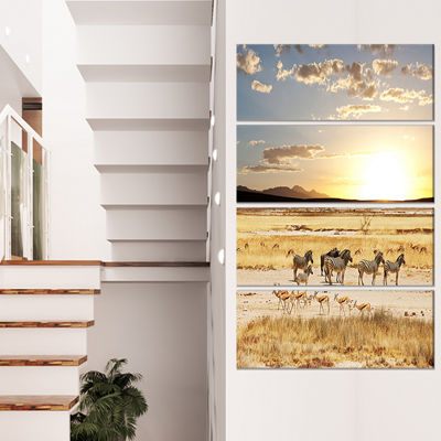 Designart Zebras and Antelopes in Africa OversizedAfrican Landscape Canvas Art - 4 Panels