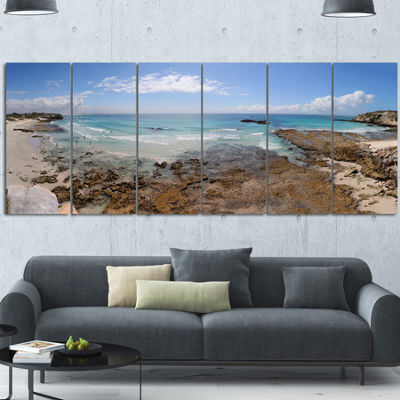 Designart The Rocks And Beach Panorama Seashore Canvas Art Print - 7 Panels