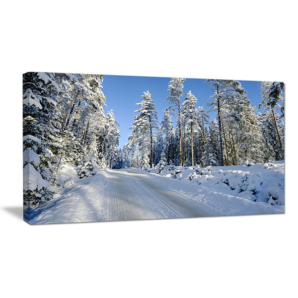 Designart Snowy Blue Winter Landscape PhotographyCanvas Art Print