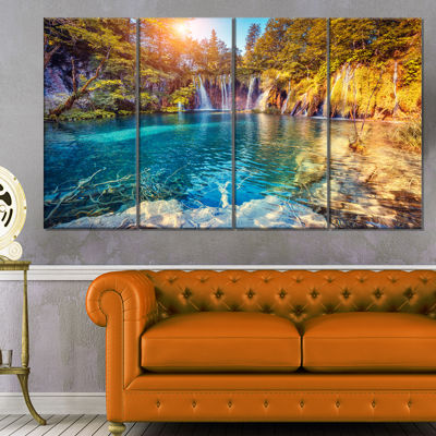 Designart Turquoise Water And Sunny Beams Landscape Photography Canvas Print - 4 Panels