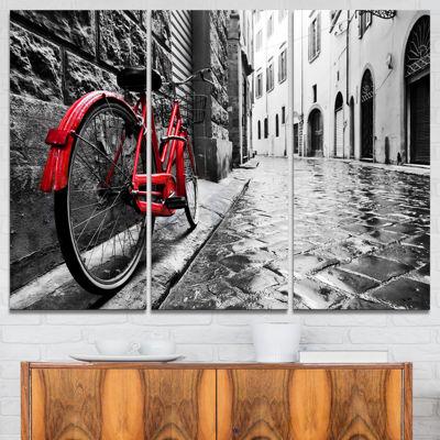 Designart Retro Vintage Red Bike Cityscape PhotoCanvas Art Print - 3 Panels