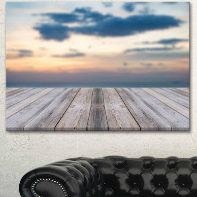 Designart Wooden Board At Sunset Seashore Modern Canvas Art Print