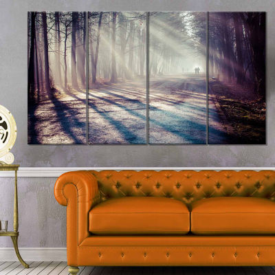 Designart Strong Sunbeams In Thick Forest Landscape Photography Canvas Print - 4 Panels