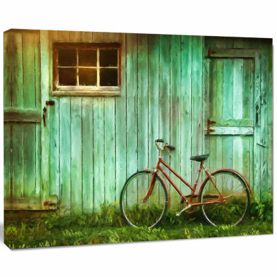Designart Old Bicycle Against Barn Landscape PhotoCanvas Art Print