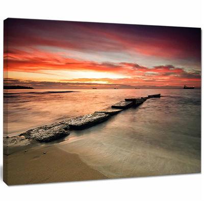 Designart Wonderful Sunrise On Black Ocean Beach Photo Canvas Print