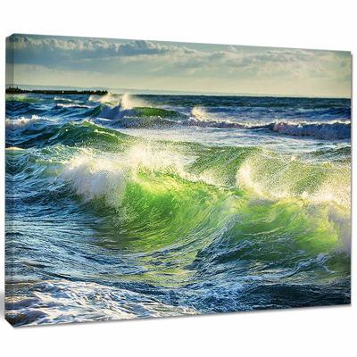 Designart Sunrise And Shining Waves In Ocean BeachPhoto Canvas Print