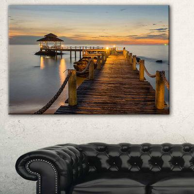 Designart Brown Wooden Pier In Evening Seashore Photo Canvas Print