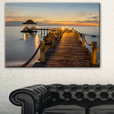 Designart Brown Wooden Pier In Evening Seashore Photo Canvas Print