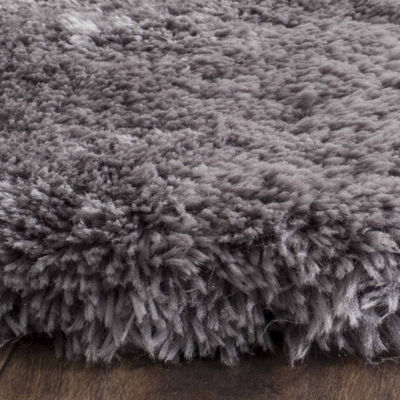 Safavieh Talia Swivel Hand Tufted Shag Area Rug