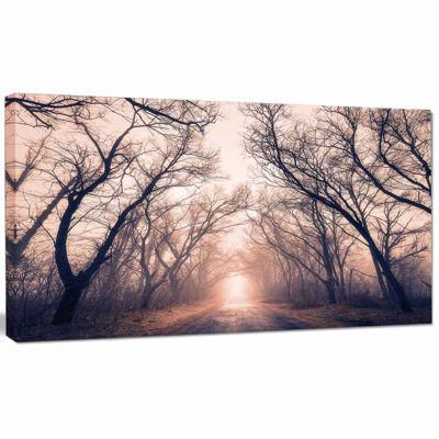 Designart Road Through Mystical Dark Forest Landscape Photography Canvas Print