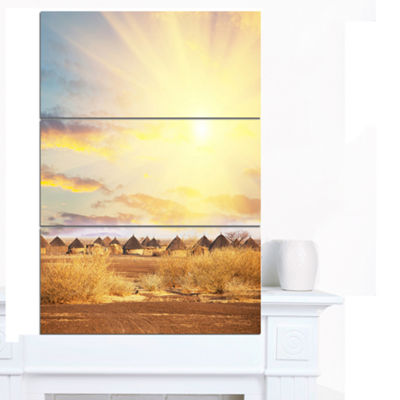 Designart African Huts Under Colorful Sky Extra Large Landscape Canvas Art - 3 Panels