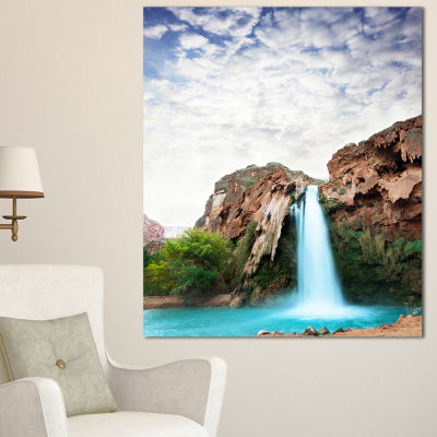 Designart Amazing Waterfall Under Cloudy Sky Oversized Landscape Canvas Art