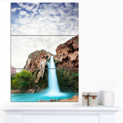 Designart Amazing Waterfall Under Cloudy Sky Oversized Landscape Canvas Art - 3 Panels