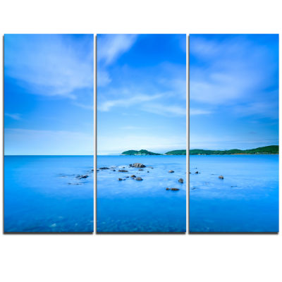 Designart Baratti Bay Small Rocks In Blue Sea Extra Large Seashore Triptych Canvas Art