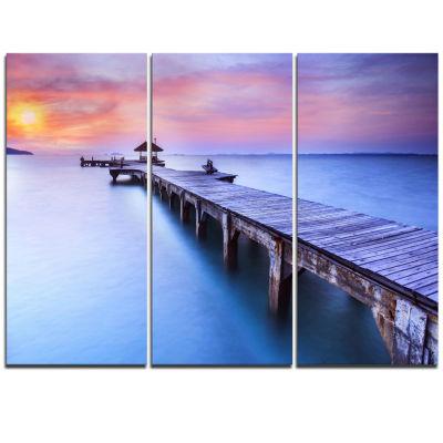 Designart Beach With Blue Waters And Wood Bridge Pier Triptych Canvas Art Print