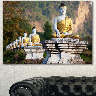 Designart Beautiful Row Of Buddha Statues Oversized Landscape Canvas Art