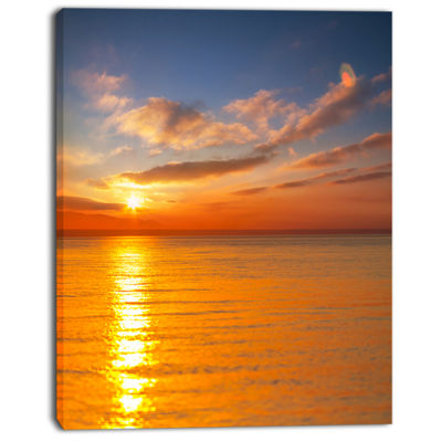 Designart Beautiful Sunset Reflecting In Sea LargeSeashore Canvas Print