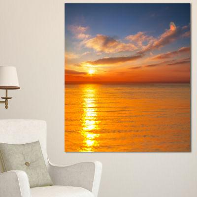 Designart Beautiful Sunset Reflecting In Sea LargeSeashore Canvas Print