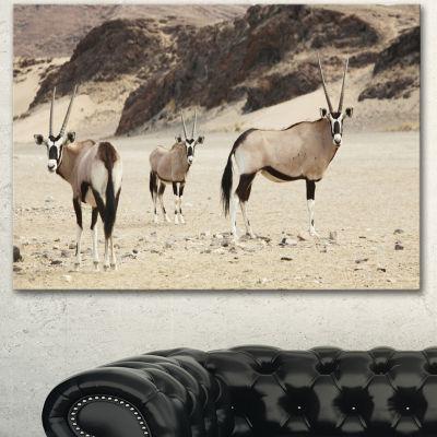 Designart Beautiful Wildebeests On Valley Landscape Artwork Canvas - 3 Panels