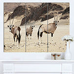 Designart Beautiful Wildebeests On Valley Landscape Artwork Canvas - 3 Panels