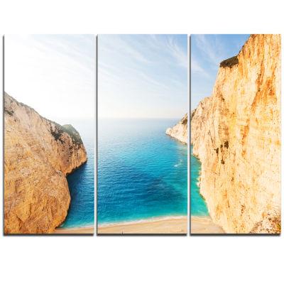 Designart Blue Sea In Between Big Rocks Extra Large Seashore Triptych Canvas Art